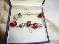 Charm Bracelet Sterling Silver by Rhona Sutton with 9 silver and glass charms