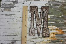 "6"" tall, steel / metal, capitalized letter ""M"" with rust finish"