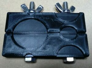 Black Coin holding clamp / vice, for cleaning and inspecting coins.