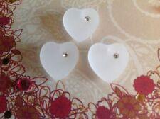 Bigiotteria bianco con cuore in cristallo