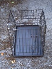 Pet transport and holding cage