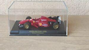 Ferrari F310 1996 Michael Schumacher modellino IXO 1/43 die cast livrea Marlboro