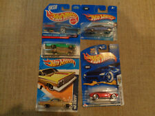 Hot Wheels assorted 4 cars. 62 chevy.