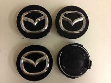 Juego De 4 Mazda cara 56 Mm Clip 56 Mm Ruedas De Aleación Centro Tapas Set [ negro ]