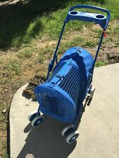 Used blue Four Paw pet stroller for small dogs and cats in good condition