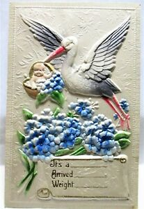 1910 EMBOSSED POSTCARD STORK WITH BABY IN BASKET, FORGET-ME-NOTS