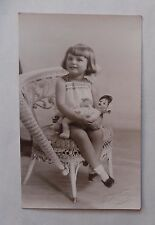 c1925 B/W Photograph. Girl (c5-y-o) in Embroidered Dress. Seated, with Doll
