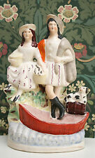 A c19th Antique Polychrome Staffordshire Figure Group, Highland Couple & Boat