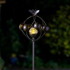 More details for aura metal garden wind spinner led colour change light solar powered glass globe