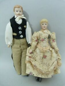 Pair of antique vintage dolls house dolls gentleman and lady in handmade outfits