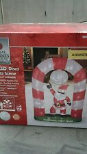 Home Accents Holiday Outdoor Lighted Christmas Inflatable Disco Santa Candy Cane
