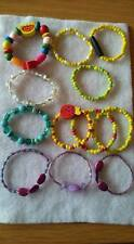 JL10 12 KIDS/SMALL BRACELETS CERAMIC/WOODEN/SYNTHETIC BEADS ON ELASTIC SALE NEW