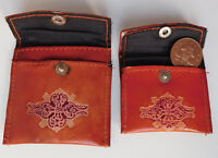 2 vintage tooled leather coin purses embossed with traditional design