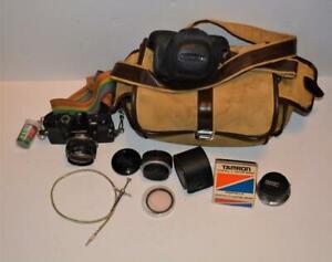 Olympus OM-1 35mm SLR camera w F.Zuiko Auto-S,custom mount tele converter ,bag