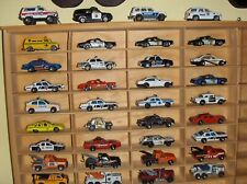 Lot of 36 Diecast Police Cars & Tow Trucks. 1:64 Scale. Various Brands.