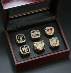 A Set Michael Jordan Chicago Bulls Championship Rings With Wooden Display Case