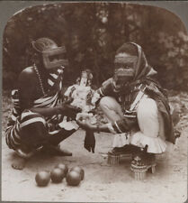 More details for east africa stereoview. swahili women holding a fetich that keeps off devils