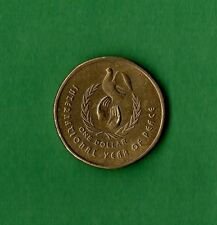 """1986 Australian $1 Coin in Archive Holder – """"Year of Peace"""" Commemorative Coin"""