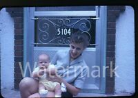 1960s Kodachrome Photo slide Lady with baby on porch