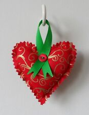 Handmade, padded, hanging heart with a Christmas theme.