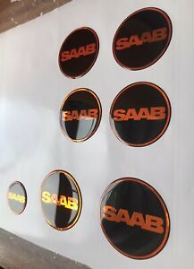 Saab Gel Domed Overlay Badges Front Back S/W + 4 X Centre Caps Any Colours