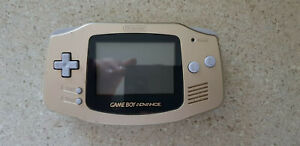 Gold Nintendo Game Boy Advance with GBA and GBC games