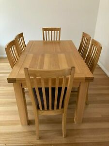 Dining table, solid timber, extendable, with 6 chairs. Sturdy metal extension me