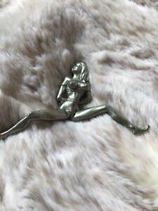 Erotic metal figurine
