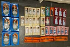 Job lot of 39 porcelain dolls in boxes new with 3 wooden seesaws also new in box