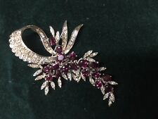 Ruby & Diamond Brooch. Exquisite white Gold, 17 Rubies and 102 Diamonds