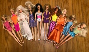VINTAGE LOT OF 10 Barbie Dolls with clothes Blonde & Black/Brown Hair