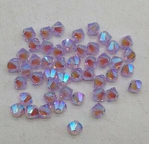 24pc Swarovski Crystal Violet AB2X 4mm Bicone 5328 Beads; Iridescent