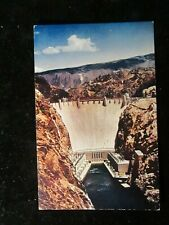 POSTCARD. GIANT BOULDER DAM AS SEEN FROM THE RUGGED CANYONS BELOW