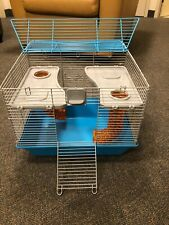 Two level hamster cage w/ tubes, food bowl, water bottle, litterbox, wheel & bed