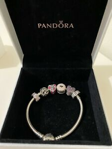 Genuine Pandora charm bracelet with genuine charms. A Gift never been worn.