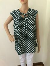 Merona women's Blouse XL made in china 100% poliester,machine wash cold.