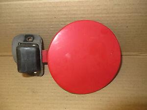 MERCURY CAPRI 94 1994 FUEL FILLER DOOR RED