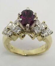 18 K Yellow Gold ring with Diamonds and Rhodolite Garnet