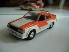 Yonezawa Diapet Mitsubishi Lancer 2000 rally Turbo in Orange/White on 1:43