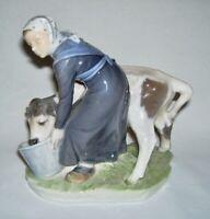Royal Copenhagen ~ Fine Porcelain MILKMAID FEEDING CALF Figurine (#779)~ Denmark