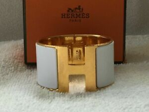 HERMES CLIC CLAC H WHITE ENAMEL AND GOLD PLATED BRACELET GM