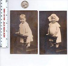 RPPC LOT OF 2 LITTLE GIRL IN DRESS AND BONNET POSED WITH CHAIR KRUXO 1907 1920s