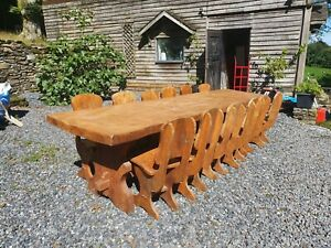 Substantial solid wood country farmhouse 12 seat setting dining table and chairs