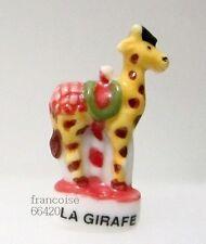Fève de collection porcelaine / DE LA SERIE LE MANEGE / LA GIRAFE