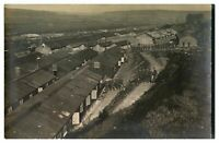Antique WW1 military RPPC postcard extensive army camp view soldiers & huts