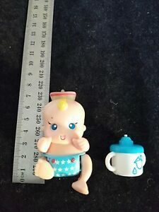 Tomy my little baby micro baby pets.  Interactive Baby Doll 2003 bottle crawling
