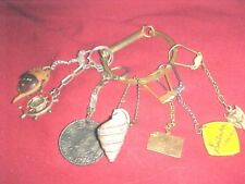 7 WATCH FOBS OR KEY CHAINS HANGING FROM LARGE GOLDTONE CIRCLE   825