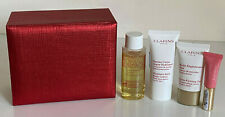 CLARINS TONING LOTION / BODY LOTION / EXTRA-FIRMING DAY CREAM / LIP GLOSS SET