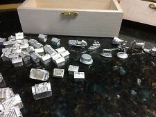 Sterling Silver Monopoly Pieces: Hotels (22), Houses (32) and Games Pieces (8)