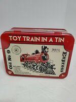 Toy Train in a Tin Box inc Locomotive Coal Car Cargo Car Caboose 12 pc track set